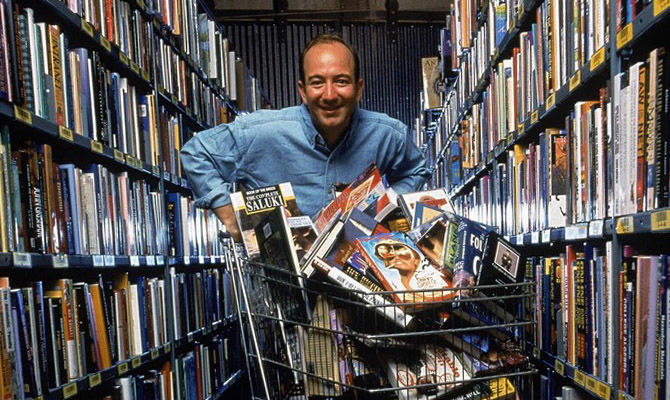 Jeff Bezos among the shelves of books rolls a basket of books